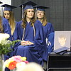 "JULIE CROTHERS BEER | THE GOSHEN NEWS<br /> A photo of former Clinton Christian School classmate Benjamin Eash sits on the chair next to the class of 2016. Eash died of cystic fibrosis when he was a freshman at Clinton Christian and received an ""in memoriam"" diploma Friday night."