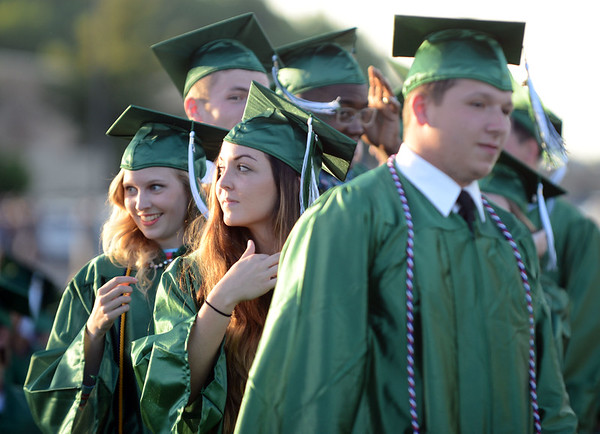 HALEY WARD | THE GOSHEN NEWS<br /> Kaitlyn Copsey and Nicky Chupp look at the crowd during Concord High School's Graduation on Thursday.