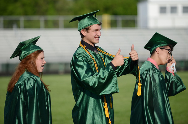 HALEY WARD | THE GOSHEN NEWS<br /> Students file in to the football stadium during Concord High School's Graduation on Thursday.