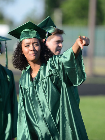 HALEY WARD | THE GOSHEN NEWS<br /> Jasmein Greer points to friends and family in the stands during Concord High School's Graduation on Thursday.