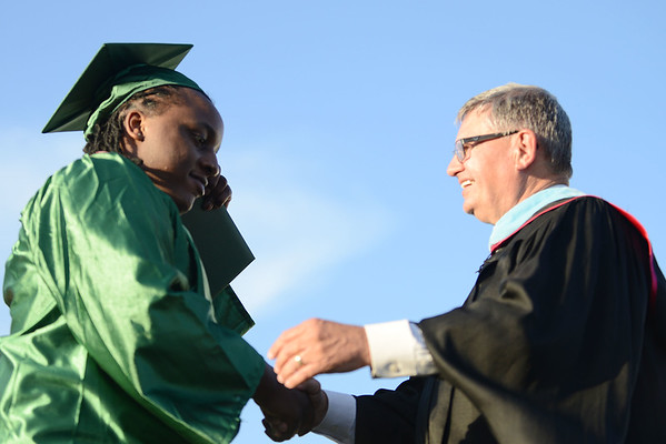 HALEY WARD | THE GOSHEN NEWS<br /> Johnnie Robinson shakes hands with Principal Dan Cunningham during Concord High School's Graduation on Thursday.