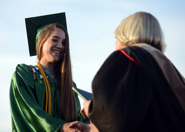 HALEY WARD   THE GOSHEN NEWS<br /> Incala Cunningham receives her diploma during Concord High School's Graduation on Thursday.