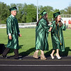 HALEY WARD | THE GOSHEN NEWS<br /> Ana Galaviz and Briceyda Gallardo Amaya laugh as students file in to the football field during Concord High School's Graduation on Thursday.