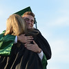 HALEY WARD | THE GOSHEN NEWS<br /> Isaiah Grathen hugs a faculty member after receiving his diploma during Concord High School's Graduation on Thursday.