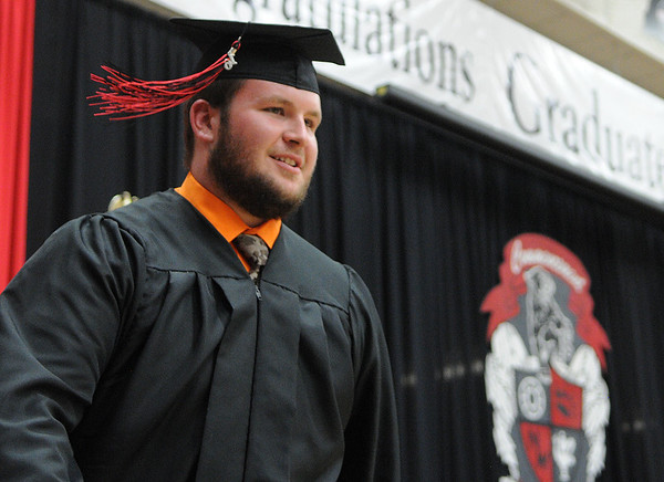 HALEY WARD | THE GOSHEN NEWS<br /> Thomas Avery smiles after receiving his diploma during NorthWood High School's Commencement on Friday.