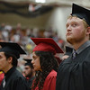 HALEY WARD | THE GOSHEN NEWS<br /> Students stand during the processional during NorthWood High School's Commencement on Friday.