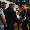 HALEY WARD | THE GOSHEN NEWS<br /> Michael Gongwer receives his diploma during NorthWood High School's Commencement on Friday.