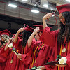 HALEY WARD | THE GOSHEN NEWS<br /> Students turn their tassels during NorthWood High School's Commencement on Friday.