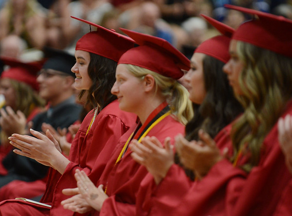HALEY WARD | THE GOSHEN NEWS<br /> Students clap after Regan Beck's speech during NorthWood High School's Commencement on Friday.