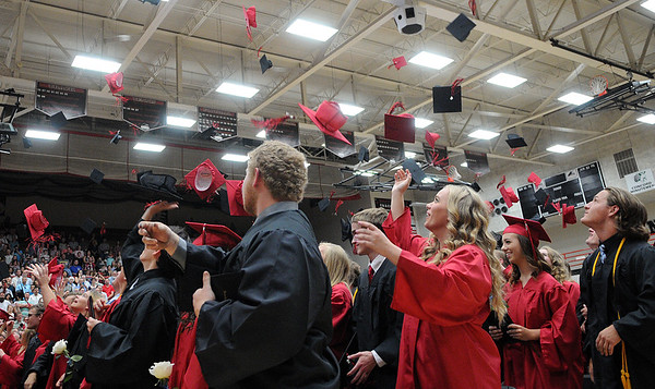 HALEY WARD | THE GOSHEN NEWS<br /> Students throw their caps in the air after graduating during NorthWood High School's Commencement on Friday.