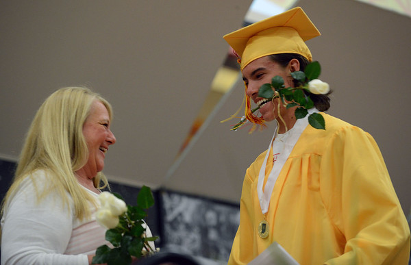 HALEY WARD | THE GOSHEN NEWS<br /> Senior class sponsor Dawn Cowley laughs after handing Kade Andrew Miller a rose during the Westview Jr-Sr High School Graduation on Friday.