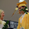 HALEY WARD | THE GOSHEN NEWS<br /> Senior class sponsor Dawn Cowley laughs after handing Kade Andrew Miller a rose during the Westview Jr-Sr High School Graduation on Friday.
