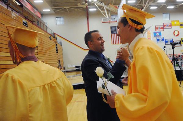 HALEY WARD | THE GOSHEN NEWS<br /> Principal Rich Cory high fives Landon Jon Yoder during the Westview Jr-Sr High School Graduation on Friday.