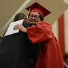 HALEY WARD | THE GOSHEN NEWS<br /> Jazzimyn Nicole Neal-Yoder hugs Principal Rich Cory after receiving her diploma during the Westview Jr-Sr High School Graduation on Friday.