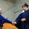HALEY WARD | THE GOSHEN NEWS<br /> Head of school Tim Lehman shakes hands with Mason Tollar during Bethany Christian High School's commencement on Sunday.
