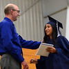 HALEY WARD | THE GOSHEN NEWS<br /> Head of school Tim Lehman hands Alicia Thomas her diploma during Bethany Christian High School's commencement on Sunday.