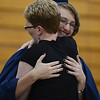HALEY WARD | THE GOSHEN NEWS<br /> Student Isabel Rondo hugs class sponsor Renae Yoder during Bethany Christian High School's commencement on Sunday.