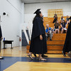 Students walk into the gym during the processional at Bethany Christian High School's commencement on Sunday.