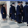 HALEY WARD | THE GOSHEN NEWS<br /> Students line up outside the gym before Bethany Christian High School's commencement on Sunday.