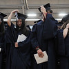 HALEY WARD | THE GOSHEN NEWS<br /> Students turn their tassels to the right to signify graduating during Bethany Christian High School's commencement on Sunday. The graduating class had 33 students.