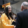 LYNNE ZEHR | THE GOSHEN NEWS Fairfield senior Laura Chupp receives her diploma Sunday.