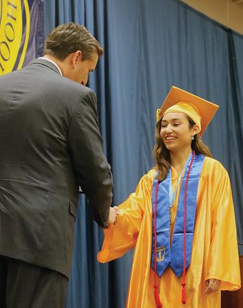 LYNNE ZEHR   THE GOSHEN NEWS Fairfield senior Yasmine Mendoza receives her diploma Sunday.