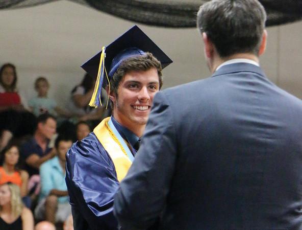 LYNNE ZEHR | THE GOSHEN NEWS Fairfield senior Brock Goeglein receives his diploma Sunday.