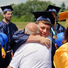 Reid Kammerdiener is greeted by his grandfather, Harry Hutchison, after commencement.