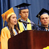 LYNNE ZEHR | THE GOSHEN NEWS Shelby Graber, Senior Class Vice-President, speaks during the Fairfield High School commencement Sunday. In back are Mitchell Holsopple, secretary, and Alec Brock, treasurer.