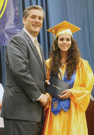 LYNNE ZEHR | THE GOSHEN NEWS Fairfield senior Kelsey Beyeler receives her diploma from Superintendent Steve Thalheimer Sunday.