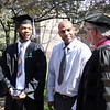 STEPHEN BROOKS | THE GOSHEN NEWS<br /> Goshen College graduating senior Dominique Bolden, left, and his father Eddie Bolden, center, talk with a Goshen College faculty member after Sunday's commencement ceremony.