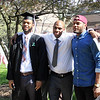 STEPHEN BROOKS | THE GOSHEN NEWS<br /> Goshen College graduating senior Dominique Bolden, left, poses for a photo alongside his father, Eddie Bolden, center, and brother, Antonio Johnson, right, after Sunday's commencement ceremony.