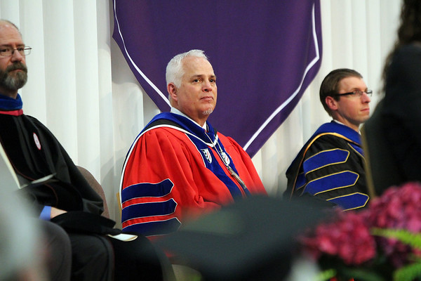 SHERRY VAN ARSDALL | THE GOSHEN NEWS<br /> James Brenneman, president of Goshen College, during the 118th Goshen College Commencement Sunday in the Roman Gingerich Recreation-Fitness Center.