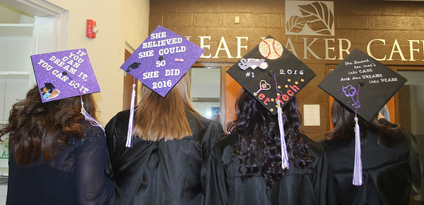 SHERRY VAN ARSDALL | THE GOSHEN NEWS<br /> Four friends in the adult program decorated their caps for the 118th Goshen College Commencement Sunday. The friends receiving their diplomas are from left, Lupe Nelson, Dowagiac, Mich.; Stacey Miller, Dowagiac, Mich.; Morgan Owens, Chicago, Ill.; and Sarah Poisson-Osiro, South Bend.