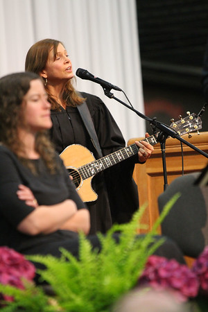 SHERRY VAN ARSDALL   THE GOSHEN NEWS<br /> Commencement speaker Carrie Newcomer sang a song during the 118th Goshen College Commencement Sunday in the Roman Gingerich Recreation-Fitness Center.