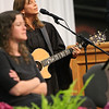SHERRY VAN ARSDALL | THE GOSHEN NEWS<br /> Commencement speaker Carrie Newcomer sang a song during the 118th Goshen College Commencement Sunday in the Roman Gingerich Recreation-Fitness Center.