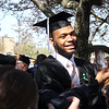 STEPHEN BROOKS | THE GOSHEN NEWS<br /> Goshen College graduating senior Dominique Bolden smiles while holding up a baby photo included in a card from family members after Sunday's commencement ceremony.