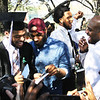 STEPHEN BROOKS | THE GOSHEN NEWS<br /> Goshen College graduating senior Dominique Bolden, left, laughs while opening a card alongside his brother, Antonio Johnson, center, and father, Eddie Bolden, right, after Sunday's commencement ceremony.