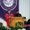 SHERRY VAN ARSDALL | THE GOSHEN NEWS<br /> James Brenneman, president of Goshen College, and Ross Peterson-Veatch, interim vice-president for academic affairs and academic dean, present degrees to the graduates during the 118th Goshen College Commencement Sunday in the Roman Gingerich Recreation-Fitness Center.
