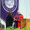 SHERRY VAN ARSDALL | THE GOSHEN NEWS<br /> James Brenneman, president of Goshen College, welcomed the commencement speaker Carrie Newcomer during the 118th Goshen College Commencement Sunday in the Roman Gingerich Recreation-Fitness Center.
