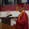HALEY WARD | THE GOSHEN NEWS<br /> Summa Cum Laude Evan Beck speaks during Goshen High School's Commencement on Sunday.