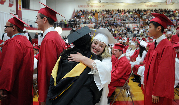 HALEY WARD | THE GOSHEN NEWS<br /> Molly Hill embraces Assistant Principal Kelly Whittaker during Goshen High School's Commencement on Sunday.