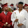 HALEY WARD | THE GOSHEN NEWS<br /> Joshua Loucks and Olivia Love smile at family in the stands during Goshen High School's Commencement on Sunday.