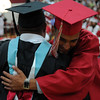 HALEY WARD | THE GOSHEN NEWS<br /> A students shake hugs Assistant Principal Robby Morgan before receiving his diploma during Goshen High School's Commencement on Sunday.