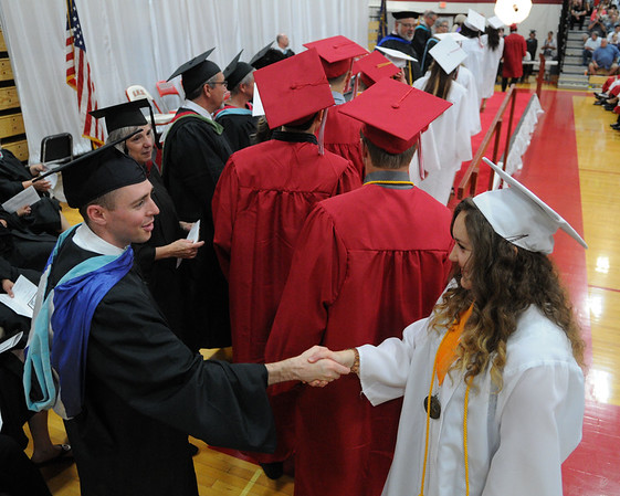 HALEY WARD | THE GOSHEN NEWS<br /> Students shake hands with faculty before receiving their diplomas during Goshen High School's Commencement on Sunday.