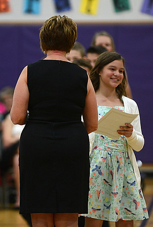 "HALEY WARD | THE GOSHEN NEWS<br /> Olivia Hilty, 12, receives an award from her teacher Rhoda McFarland during the Sixth Grade Celebration on Tuesday night at New Paris Elementary School. Hilty said she will miss her teacher the most. ""She was really nice and pushed me to do the extra mile and think harder than I usually should,"" she said."