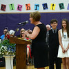 "HALEY WARD | THE GOSHEN NEWS<br /> David Sanchez, 12, and Trinity Ruiz, 12, wait to receive awards from their teacher Rhoda McFarland during the Sixth Grade Celebration on Tuesday night at New Paris Elementary School. Ruiz says she will miss the time she spends with her friends at school. ""I'm going to miss my friends because probably I won't be able to see them as much,"" she said."