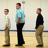 HALEY WARD | THE GOSHEN NEWS<br /> Joshua Moreland, Connor Mullins and Keegan Pressler wait in line for their awards during Sixth Grade Celebration on Tuesday night at New Paris Elementary School.