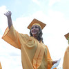 HALEY WARD | THE GOSHEN NEWS<br /> Mabel Thomas waves to family in the stands during the processional of Northridge High School's Commencement on Sunday.