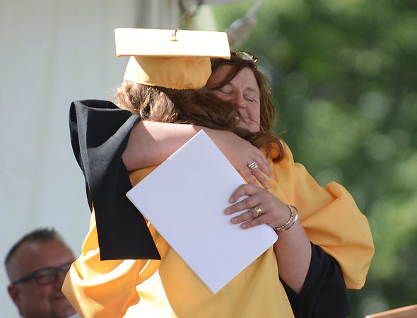 HALEY WARD | THE GOSHEN NEWS<br /> Isabella Staltari hugs her aunt Theresa Grossman, who is the selected speaker, during Northridge High School's Commencement on Sunday.